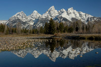 The Teton Range reflected in a pool along the Sanke River